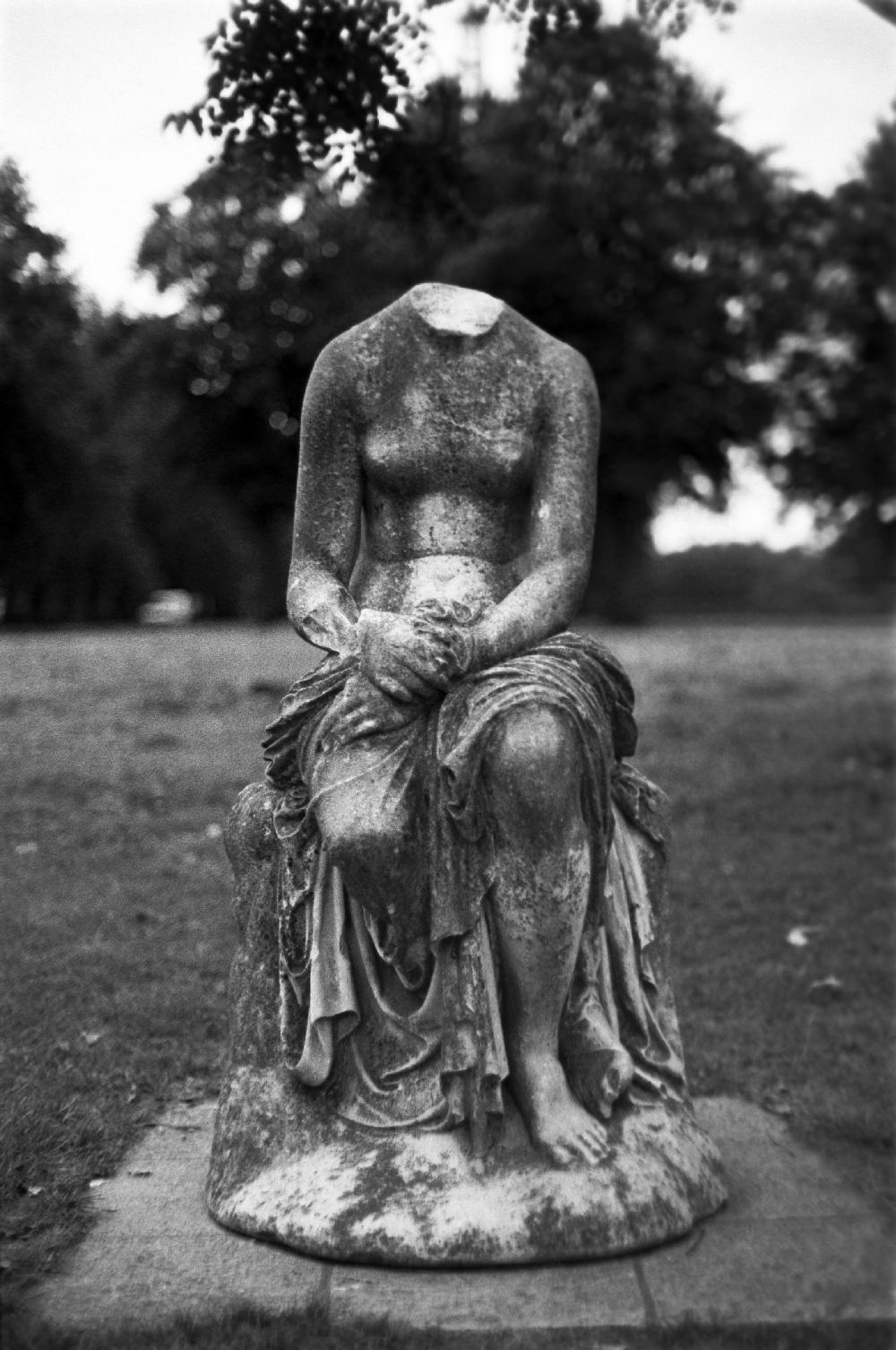 Lost head statue